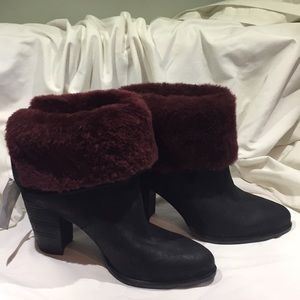 Black suede and burgundy trim UGG ankle Bootie.